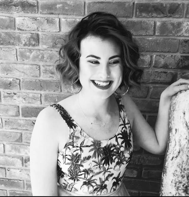 Emily Rose Wigan Singer